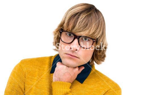 Portrait of thoughtful hipster businessman with hand on chin