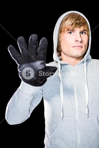 Man with black gloves staring at camera