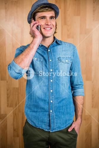 Smiling blonde hipster phone calling