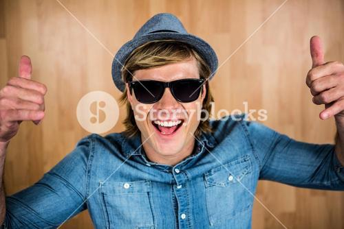 Cheerful hipster wearing sunglasses