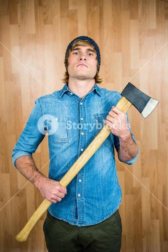 Front view of hipster standing with axe