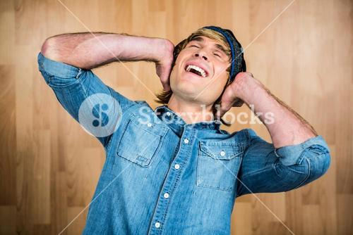 Cheerful hipster listening to music