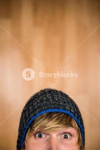 Close up of half face of hipster man