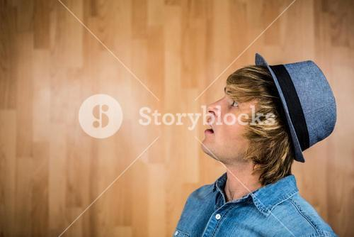 Side view of surprised hipster man