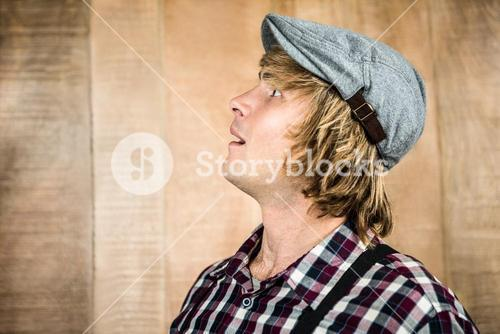 Side view of surprised blond hipster smiling
