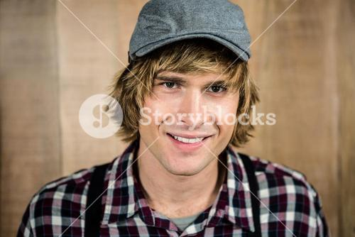 Smiling blond hipster staring at camera
