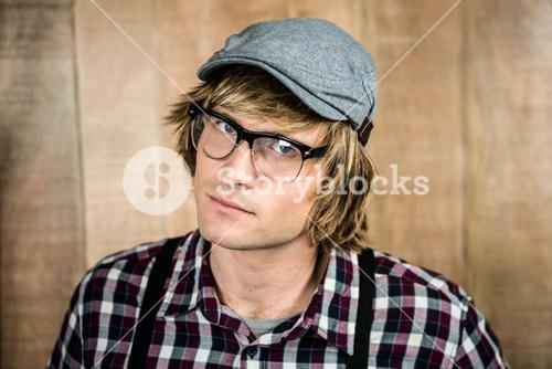 Serious blond hipster staring