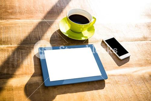 Cup of coffee and tablet pc