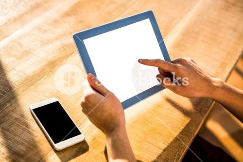 Over shoulder view of casual man using tablet