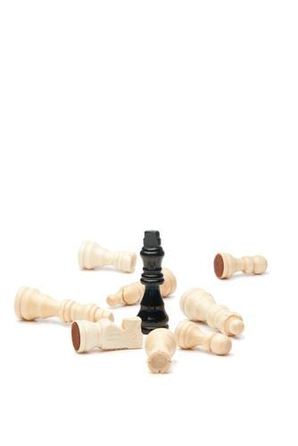 Black king and white chess pieces