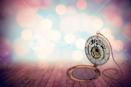 Composite image of retro styled pocket clock with chain