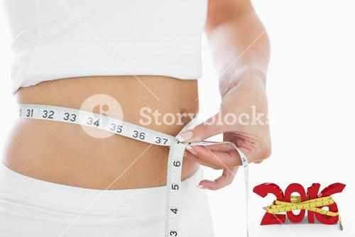 Composite image of closeup midsection of woman measuring waist