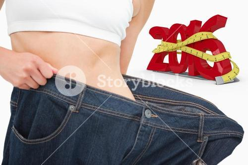 Composite image of close up of a woman waist who lost a lot of weight