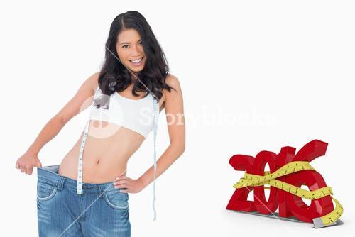 Composite image of smiling sexy woman wearing too big pants