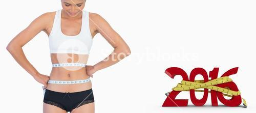 Composite image of smiling slim woman measuring her waist