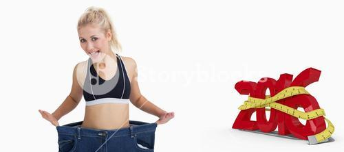 Composite image of thin woman wearing old pants after losing weight