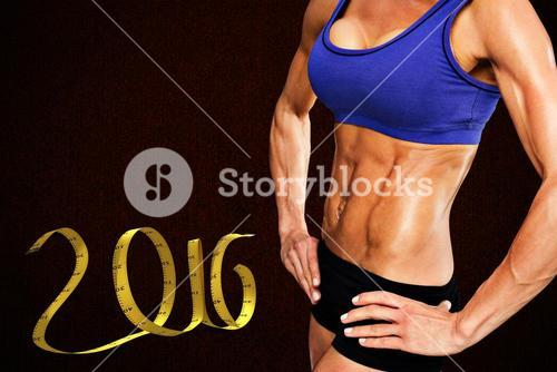 Composite image of midsection of fit woman with hand on hip