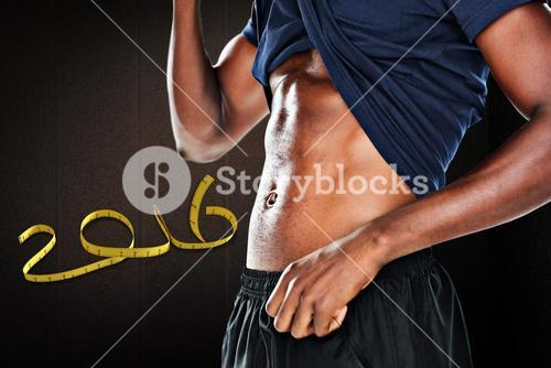 Composite image of mid section of a muscular man showing his abs