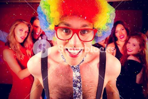 Composite image of geeky hipster in afro rainbow wig