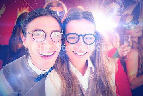 Composite image of geeky hipsters smiling at camera