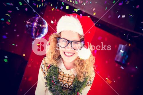 Composite image of geeky hipster smiling at camera