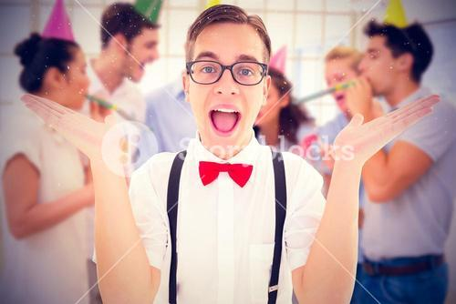 Composite image of geeky young hipster smiling at camera