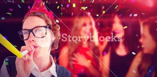 Composite image of geeky hipster wearing a party hat wig blowing party horn