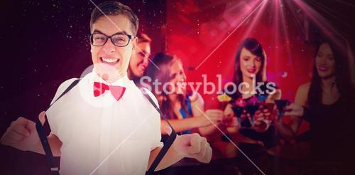 Composite image of geeky hipster pulling his suspenders