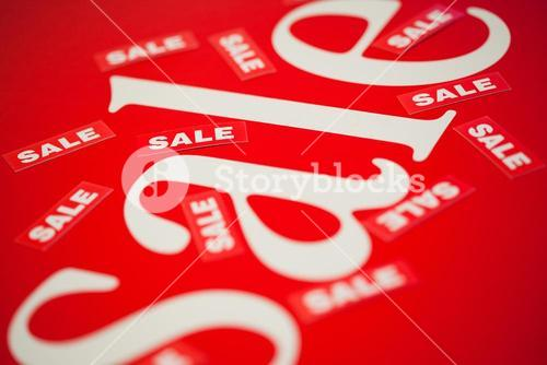 The word sale scattered on a red background