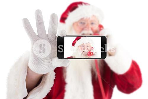 Composite image of hand holding mobile phone
