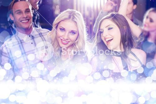 Composite image of stylish friends dancing and smiling