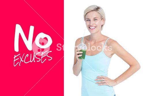 Composite image of beautiful woman holding green juice