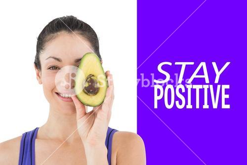 Composite image of pretty woman showing half of an avocado
