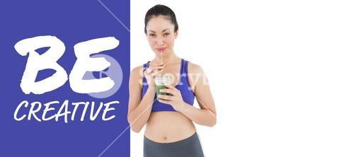 Composite image of attractive woman drinking green juice