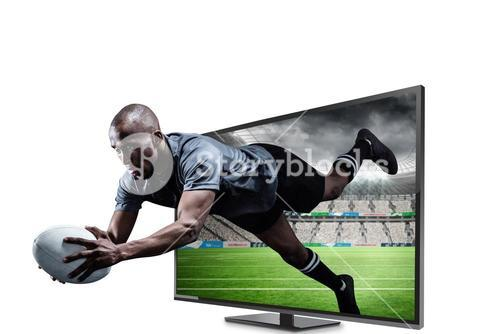 Composite image of sportsman jumping for catching rugby ball