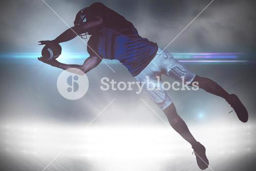 Composite image of american football player catching ball in mid-air