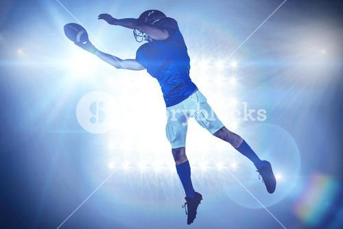 Composite image of sports player catching ball