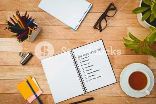 Composite image of list of new years resolution on white background
