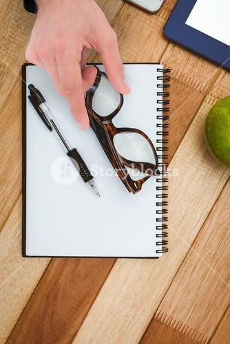 Composite image of businessman measuring something with these fingers