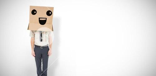 Composite image of businessman standing with box on head