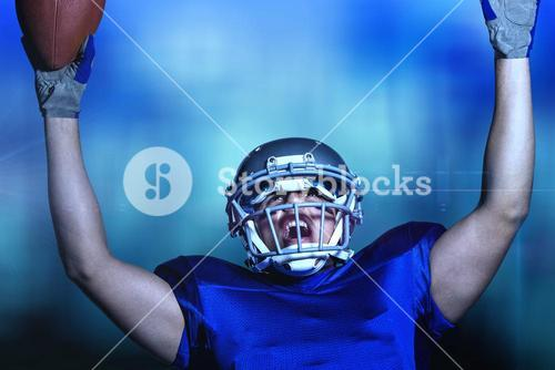 Composite image of american football player in uniform cheering