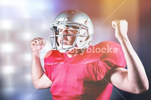 Composite image of happy sportsman cheering with clenched fist