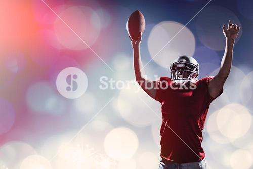 Composite image of american football player cheering while holding ball