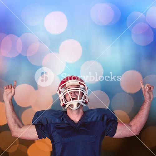 Composite image of rugby player celebrating while pointing up