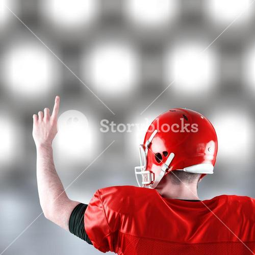 Composite image of rear view of american football player triumphing