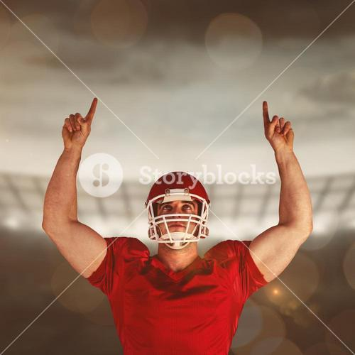 Composite image of american football player cheering