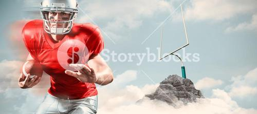 Composite image of portrait of defensive sportsman holding american football