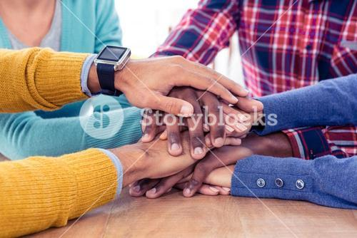 Business team stacking hands on desk