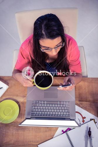 Overhead view of businesswoman using phone