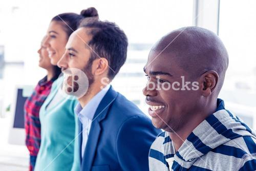 Happy business people standing in row